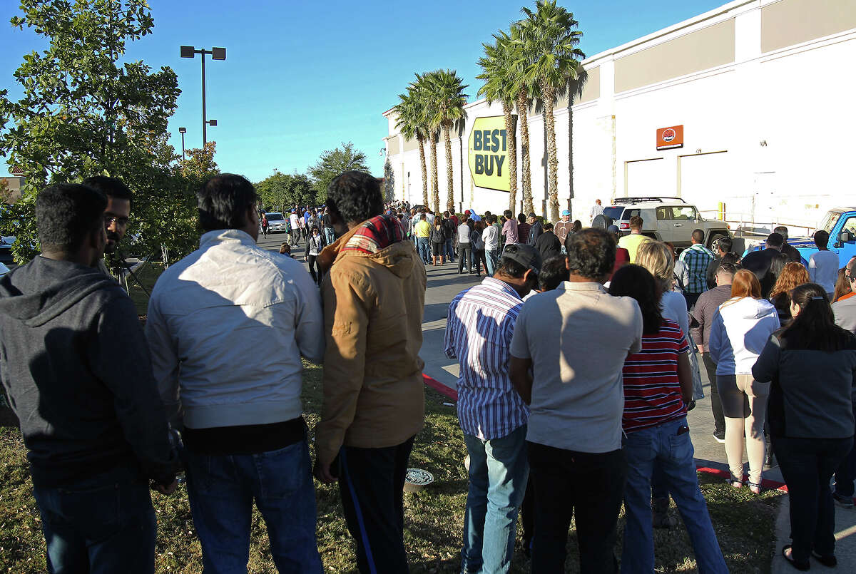 The line goes out way behind the store as shoppers start to crowd into the Best Buy store at the Rim Shopping Center on November 27, 2014.