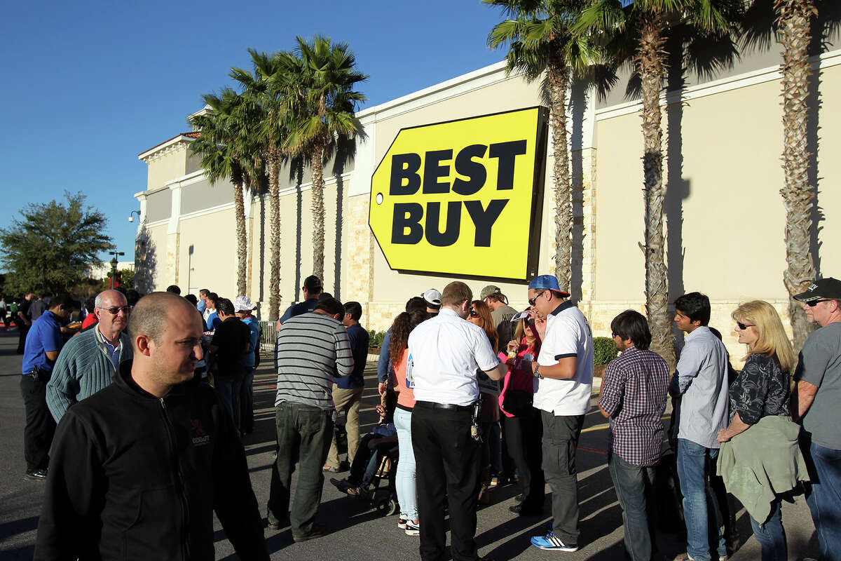 Waiting shoppers get numbers for items in the store before they crowd into the Best Buy store at the Rim Shopping Center on November 27, 2014.
