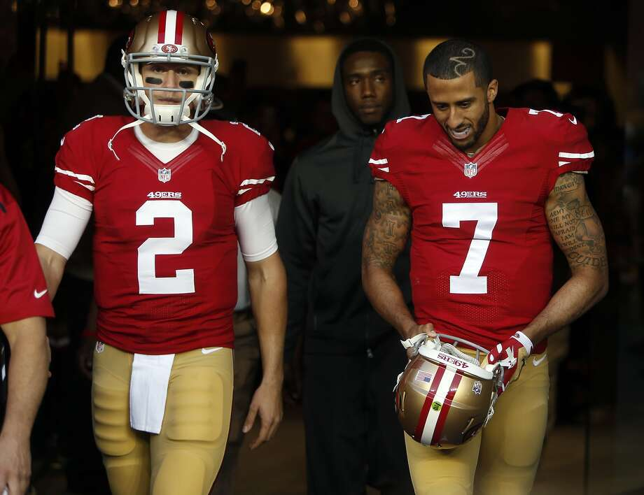San Francisco 49ers quarterbacks Blaine Gabbert and Colin Kaepernick  head to the field to warm up before playing the Seattle Seahawks in NFL game at Levi's Stadium in Santa Clara, Calif., on Thursday, November 27, 2014. Photo: Scott Strazzante, The Chronicle