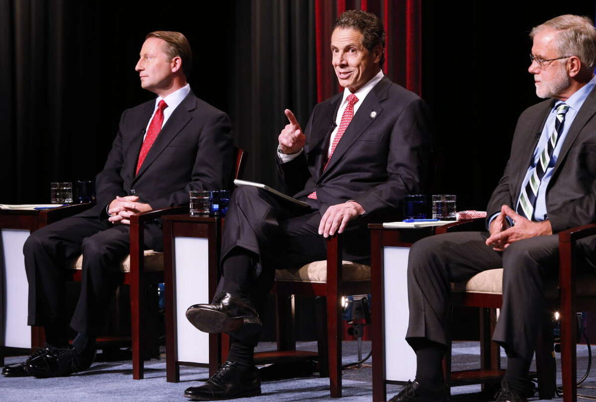 New York gubernatorial candidates, from left, Rob Astorino, Gov. Andrew Cuomo and Howie Hawkins participate in a debate sponsored by The Buffalo News and WNED-WBFO at WNED Studios in Buffalo, N.Y., Wednesday, Oct. 22, 2014. (AP Photo/The Buffalo News,Dererk Gee ) TV OUT; MAGS OUT; MANDATORY CREDIT; BATAVIA DAILY NEWS OUT; DUNKIRK OBSERVER OUT; JAMESTOWN POST-JOURNAL OUT; LOCKPORT UNION-SUN JOURNAL OUT; NIAGARA GAZETTE OUT; OLEAN TIMES-HERALD OUT; SALAMANCA PRESS OUT; TONAWANDA NEWS OUT ORG XMIT: NYBUE102