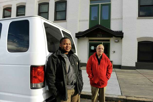 Staff van driver Rolensky Alphonse, left, and volunteer Ismael Munoz stand by the new outreach van on Tuesday, Nov. 18, 2014, at the Homeless Action Committee in Albany, N.Y. The 2014 Ford van was purchased with money raised from an online fundraising campaign Alphonse started when the old van broke down. (Cindy Schultz / Times Union) Photo: Cindy Schultz / 00029497A