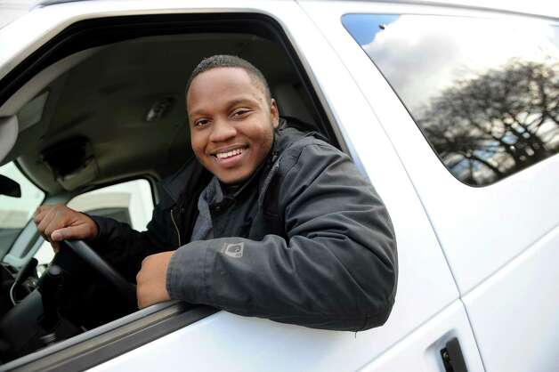 Staff van driver Rolensky Alphonse in the driver's seat of the new outreach van on Tuesday, Nov. 18, 2014, at the Homeless Action Committee in Albany, N.Y. The 2014 Ford van was purchased with money raised from an online fundraising campaign Alphonse started when the old van broke down. (Cindy Schultz / Times Union) Photo: Cindy Schultz / 00029497A