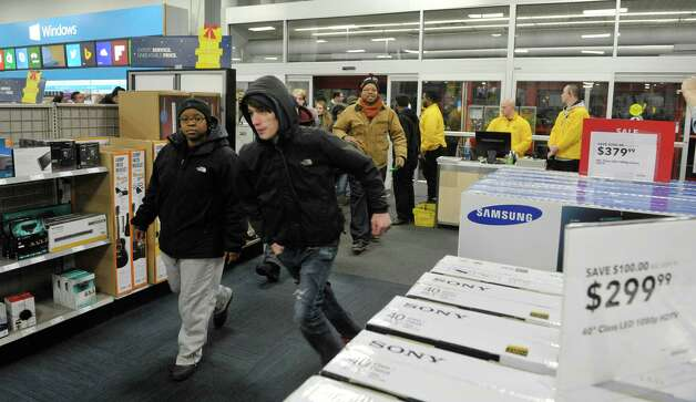 The first 50 shopper are let through the doors at Best Buy at 5pm during their Thanksgiving Day sale on Thursday, Nov. 27, 2014, in Albany, N.Y. (Paul Buckowski / Times Union) Photo: Paul Buckowski / 00029656A