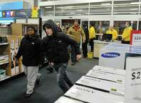 The first 50 shopper are let through the doors at Best Buy at 5pm during their Thanksgiving Day sale on Thursday, Nov. 27, 2014, in Albany, N.Y. (Paul Buckowski / Times Union)