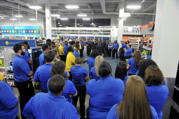Lynn Pino, background right, general manager addresses all her employees at Best Buy ten minutes before opening the doors to shopper during their Thanksgiving Day sale on Thursday, Nov. 27, 2014, in Albany, N.Y. (Paul Buckowski / Times Union) Photo: Paul Buckowski / 00029656A