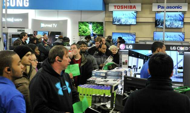 Shoppers wait in line for a television at Best Buy during their Thanksgiving Day sale on Thursday, Nov. 27, 2014, in Albany, N.Y. (Paul Buckowski / Times Union) Photo: Paul Buckowski / 00029656A