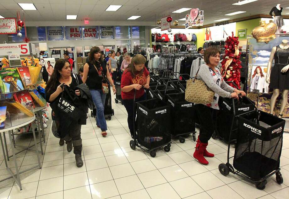 Customers rush to look for gifts after doors open during Black Friday on Thursday Nov. 27, 2014 at Kohl's. Photo: Gabe Hernandez, Associated Press