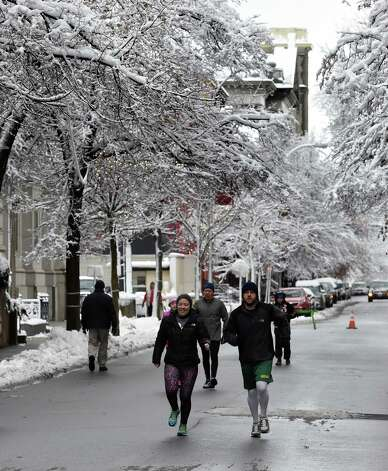 Runners warm up under the snow covered trees before the 5K Troy Turkey Trot race Thursday afternoon Nov. 27, 2014 in Troy, N.Y.      (Skip Dickstein/Times Union) Photo: SKIP DICKSTEIN / 00029599A