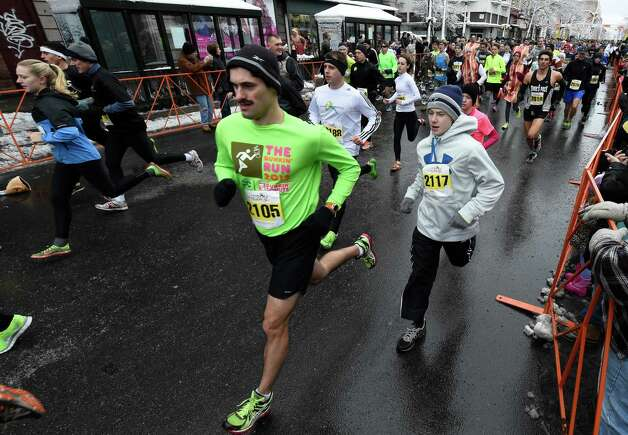 Runners in the 5K Troy Turkey Trot head off from the start Thursday afternoon Nov. 27, 2014 in Troy, N.Y.      (Skip Dickstein/Times Union) Photo: SKIP DICKSTEIN / 00029599A