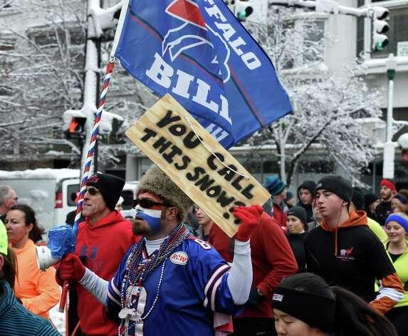A Buffalo Bills fan shows his colors in the 5K Troy Turkey Trot Thursday afternoon Nov. 27, 2014 in Troy, N.Y.      (Skip Dickstein/Times Union) Photo: SKIP DICKSTEIN / 00029599A