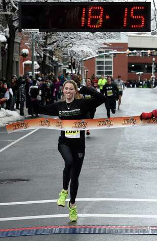 Kerry Caher, 20, of Clifton Park is the first woman to cross the finish line in the 5K Troy Turkey Trot Thursday afternoon Nov. 27, 2014 in Troy, N.Y.      (Skip Dickstein/Times Union) Photo: SKIP DICKSTEIN / 00029599A