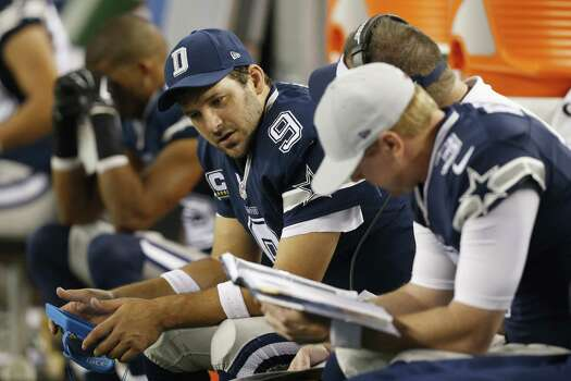 Dallas Cowboys quarterback Tony Romo examines plays during the second half of an NFL football game against the Philadelphia Eagles, Thursday, Nov. 27, 2014, in Arlington, Texas. (AP Photo/John F. Rhodes) Photo: John F. Rhodes, Associated Press / FR170608 AP