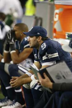 Dallas Cowboys quarterback Tony Romo sits on the sidelines during the second half of an NFL football game against the Philadelphia Eagles, Thursday, Nov. 27, 2014, in Arlington, Texas. (AP Photo/John F. Rhodes) Photo: John F. Rhodes, Associated Press / FR170608 AP