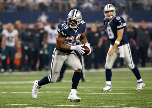 Dallas Cowboys' DeMarco Murray (29) finds running room as quarterback Tony Romo, rear, watches during the second half of an NFL football game against the Philadelphia Eagles, Thursday, Nov. 27, 2014, in Arlington, Texas. (AP Photo/John F. Rhodes) Photo: John F. Rhodes, Associated Press / FR170608 AP
