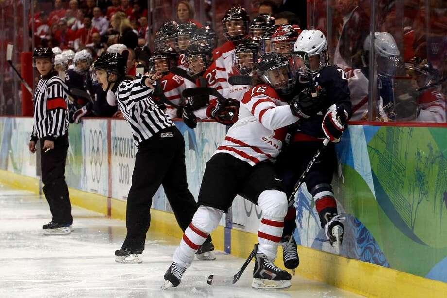 VANCOUVER, BC - FEBRUARY 25:  Natalie Darwitz #20 of the United States is checked by Jayna Hefford #16 of Canada during the ice hockey women's gold medal game between Canada and USA on day 14 of the Vancouver 2010 Winter Olympics at Canada Hockey Place on February 25, 2010 in Vancouver, Canada.  (Photo by Bruce Bennett/Getty Images) *** Local Caption *** Natalie Darwitz;Jayna Hefford Photo: Bruce Bennett, Getty Images / 2010 Getty Images