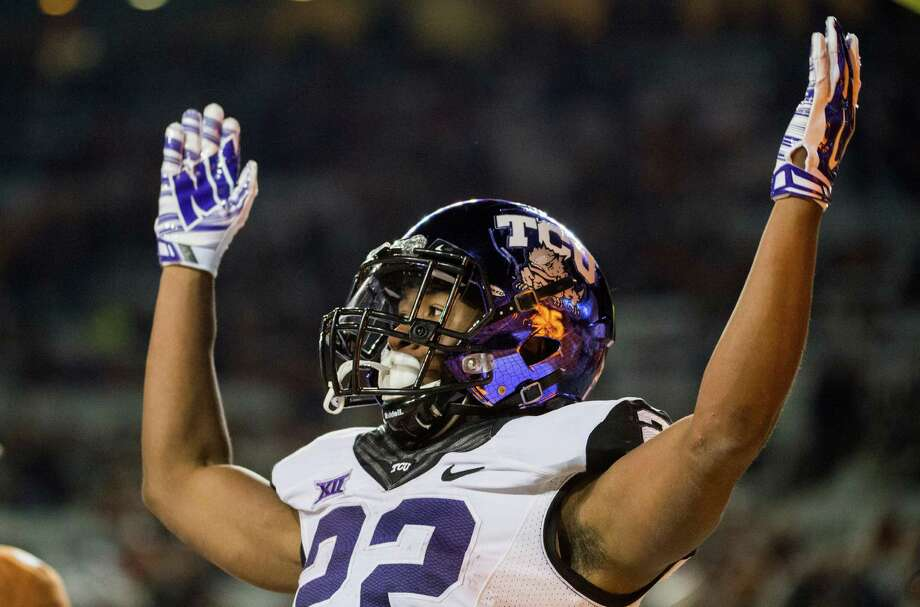 TCU's Aaron Green (22) celebrates a touchdown during the second half of an NCAA college football game against Texas, Thursday, Nov. 27, 2014, in Austin, Texas. Photo: Ashley Landis /Associated Press / FR171265 AP