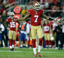 Quarterback Colin Kaepernick reacts to a fourth-quarter call by the officials, but he and the 49ers had much bigger problems in being routed by their NFC West archrivals, the Seahawks.