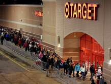 Shoppers head into Target just after thei doors opened at midnight on Black Friday, Nov. 28, 2014, in South Portland, Maine.