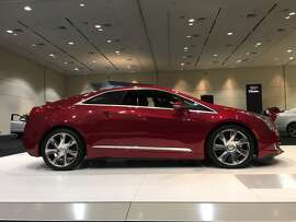 Cadillac ELR 2014 | MSRP: $75,000   The ELR gets about 40 miles on electricity stored in the battery, plus another 300 miles from its gasoline generator. It takes five hours to charge. This little coupe has a series of safety features, including lane departure warnings, front and rear park assist and forward collision alerts. And because it's electric, it does not roll back on hills.  Fuel economy | Electric: 37, Gas: City: 31 MPG Highway: 35 MPG