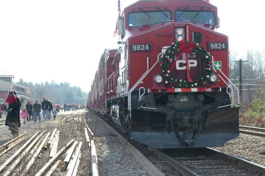 A large wreath adorns the front of the locomotive that is pulling the Canadian Pacific Holiday Train, seen here during a stop   at the Amtrak Train Station in Saratoga Springs  on Monday, Nov. 29, 2010. (Paul Buckowski / Times Union archive) Photo: Paul Buckowski / 00010931A