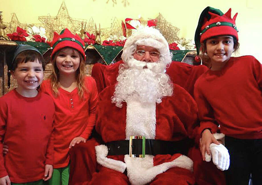 "Santa Claus and friends will again be ready to welcome young fans during ""A Visit to Santa's House,"" sponsored by the Junior Women's Club of Fairfield on Dec. 13-14 at the Burr Homestead. Photo: File Photo / Fairfield Citizen"