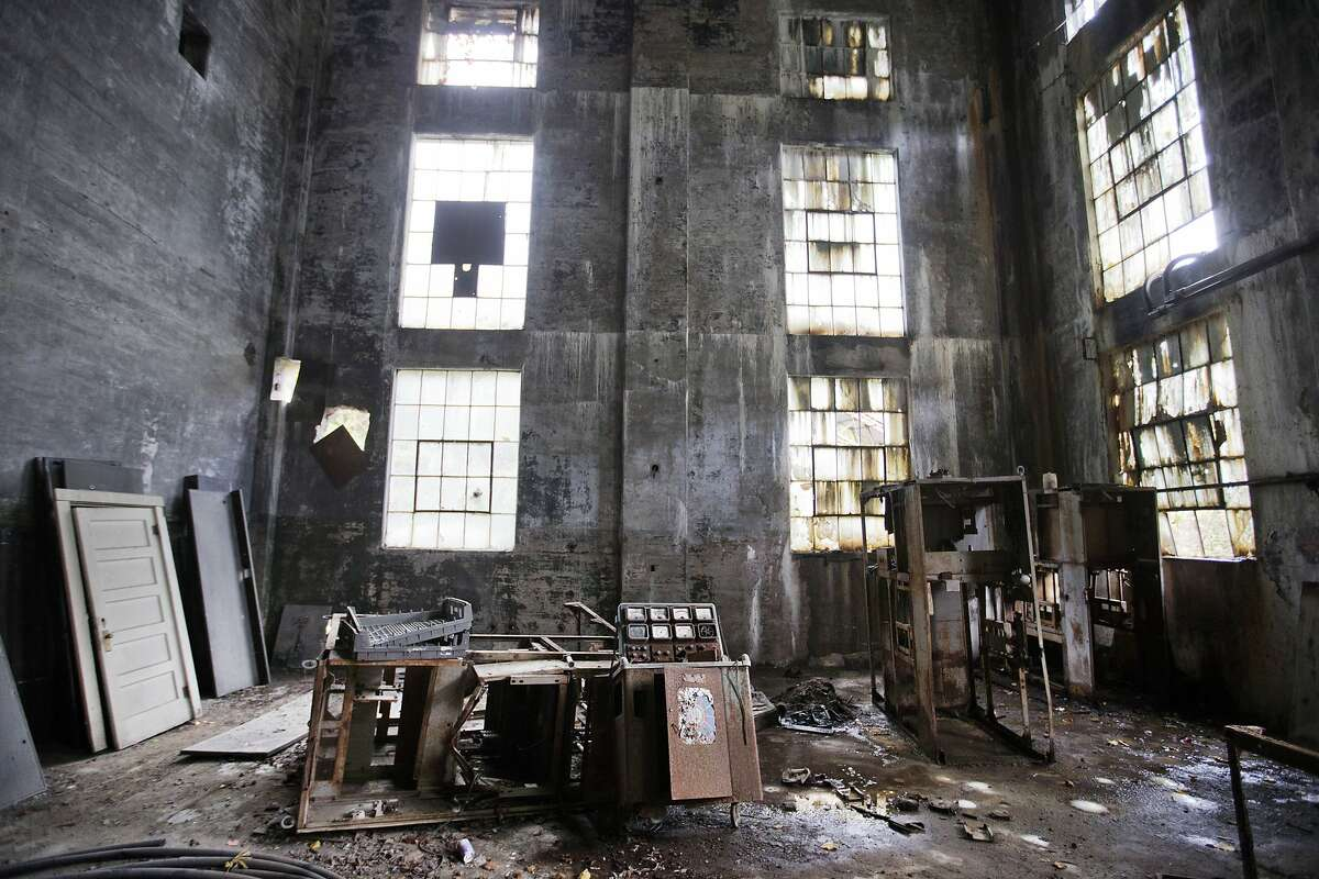 In this Oct. 15, 2014 photo, rusted equipment sits on the floor of an abandoned coal power plant in Lynch, Ky. The community of Lynch, built as a company town in 1917 by U.S. Coal and Coke, a subsidiary of U.S. Steel, was at the time the largest coal camp in the world. It was built to house the many workers mining the coal to be used by U.S. Steel. The population peaked to around 10,000 but has since diminished to roughly 747 according to a 2010 census. The plant now sits abandoned across the street from the old mines that have since been turned into a museum.