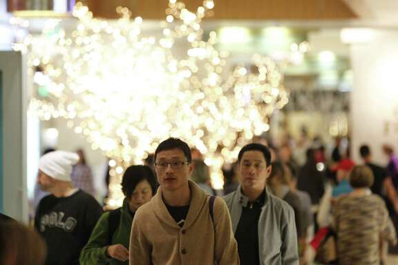 Shoppers crowd Houston's Galleria on Black Friday, Nov. 28, 2014.