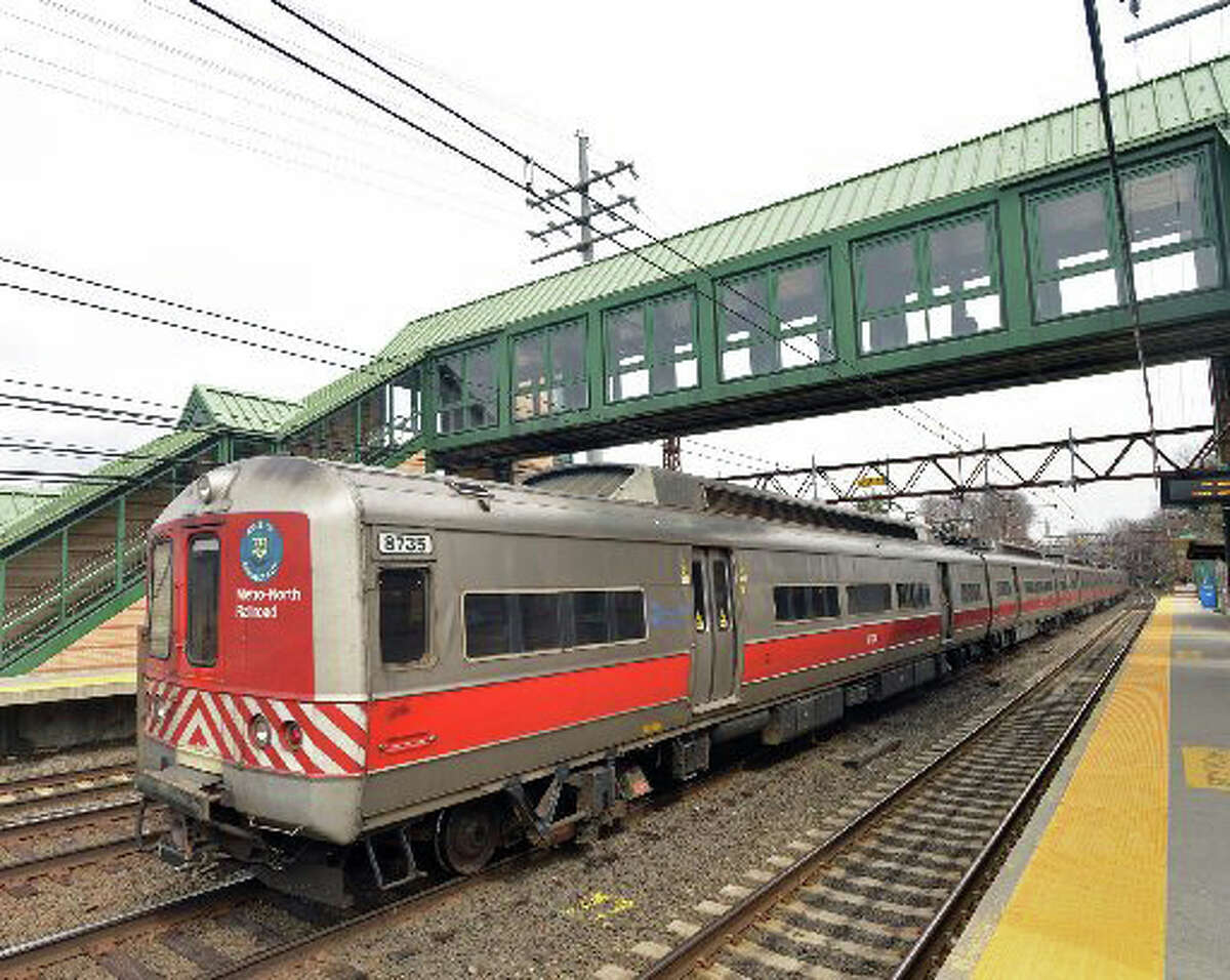 A Metro-North train passes through the central Greenwich Train Station, Tuesday afternoon, March 25, 2014.