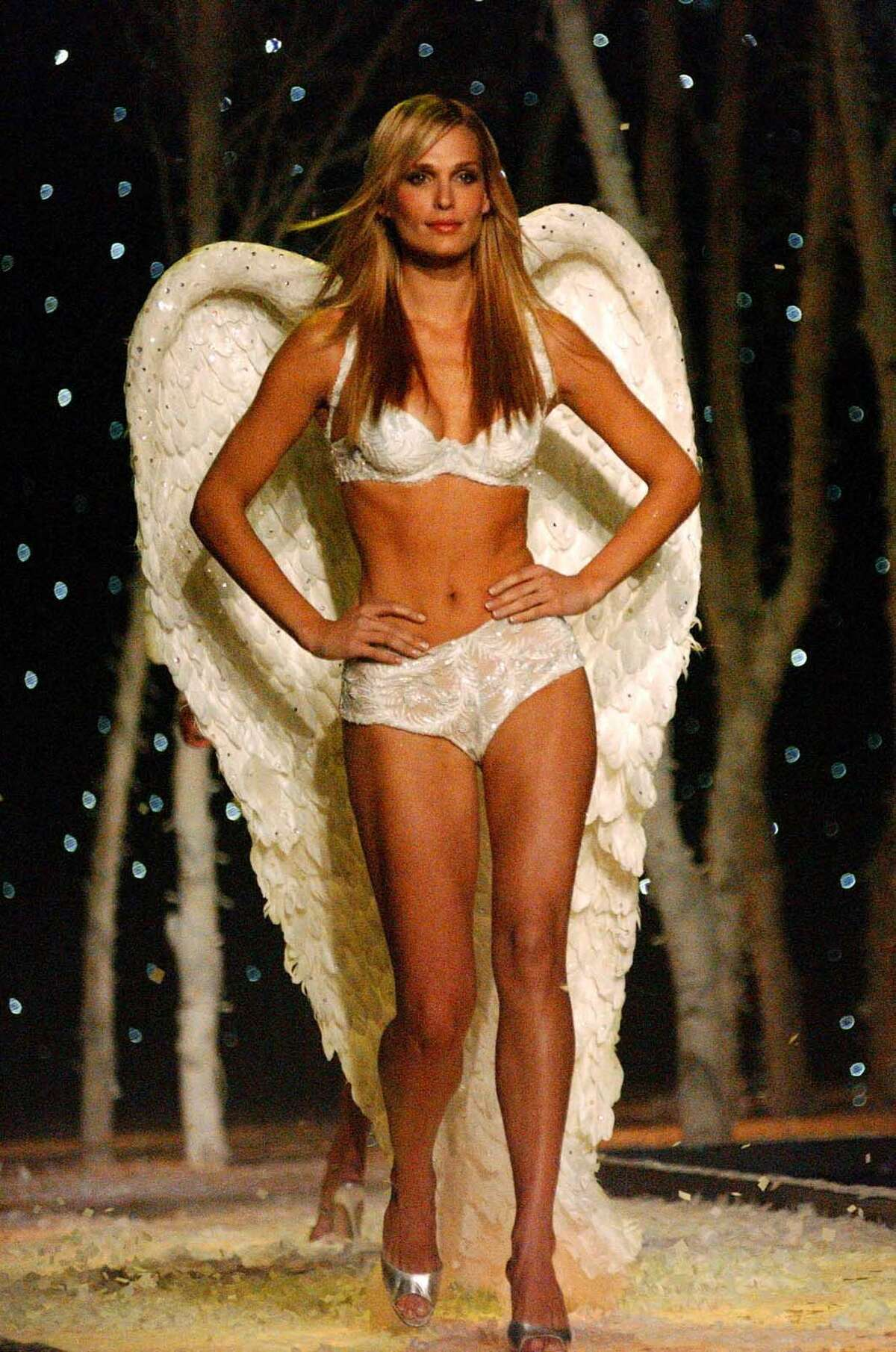Molly Sims wears a set of angel wings as she models fashions in the Victoria's Secret show Tuesday, Nov. 13, 2001, in New York.