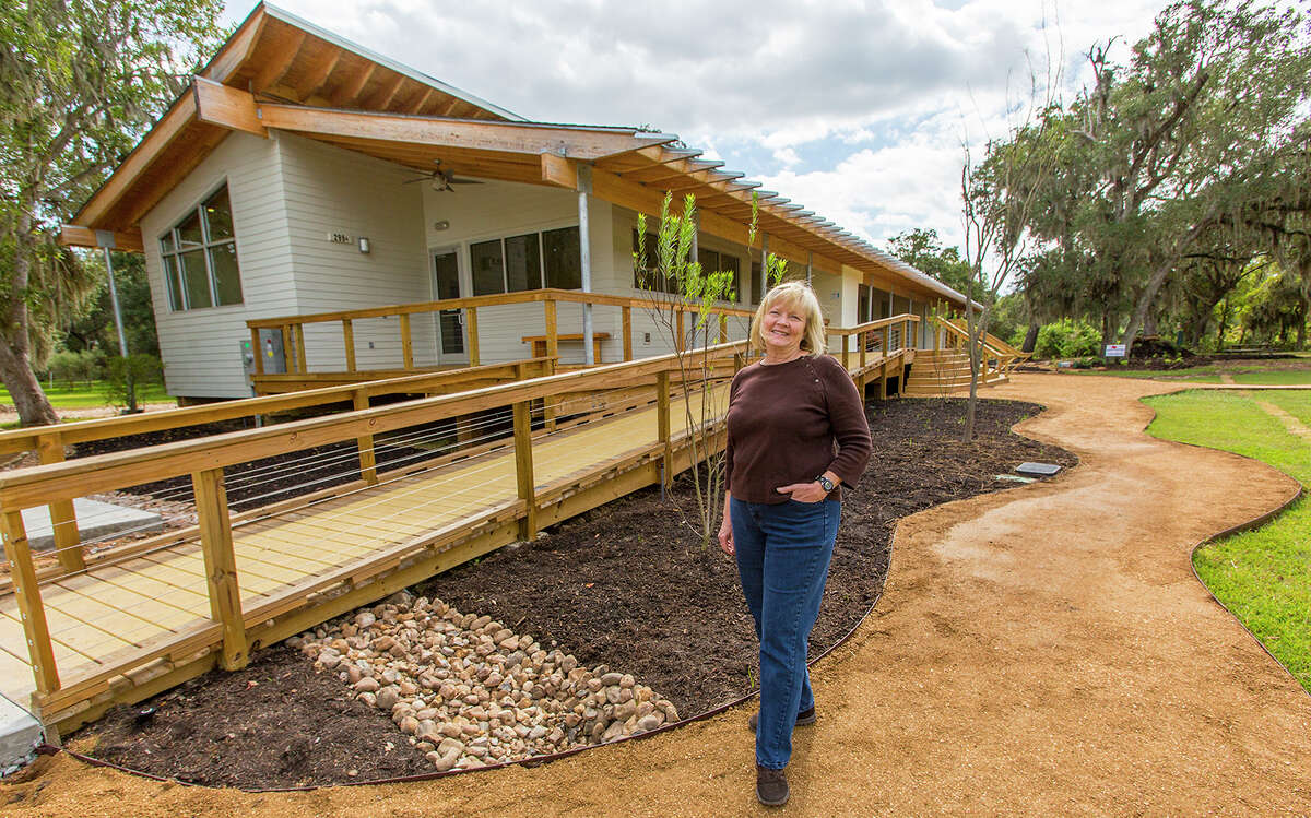 Cecilia Riley, executive director of the Gulf Coast Bird Observatory in Lake Jackson, stands in front of the new Cecilia Riley Avian Conservation Science Center.