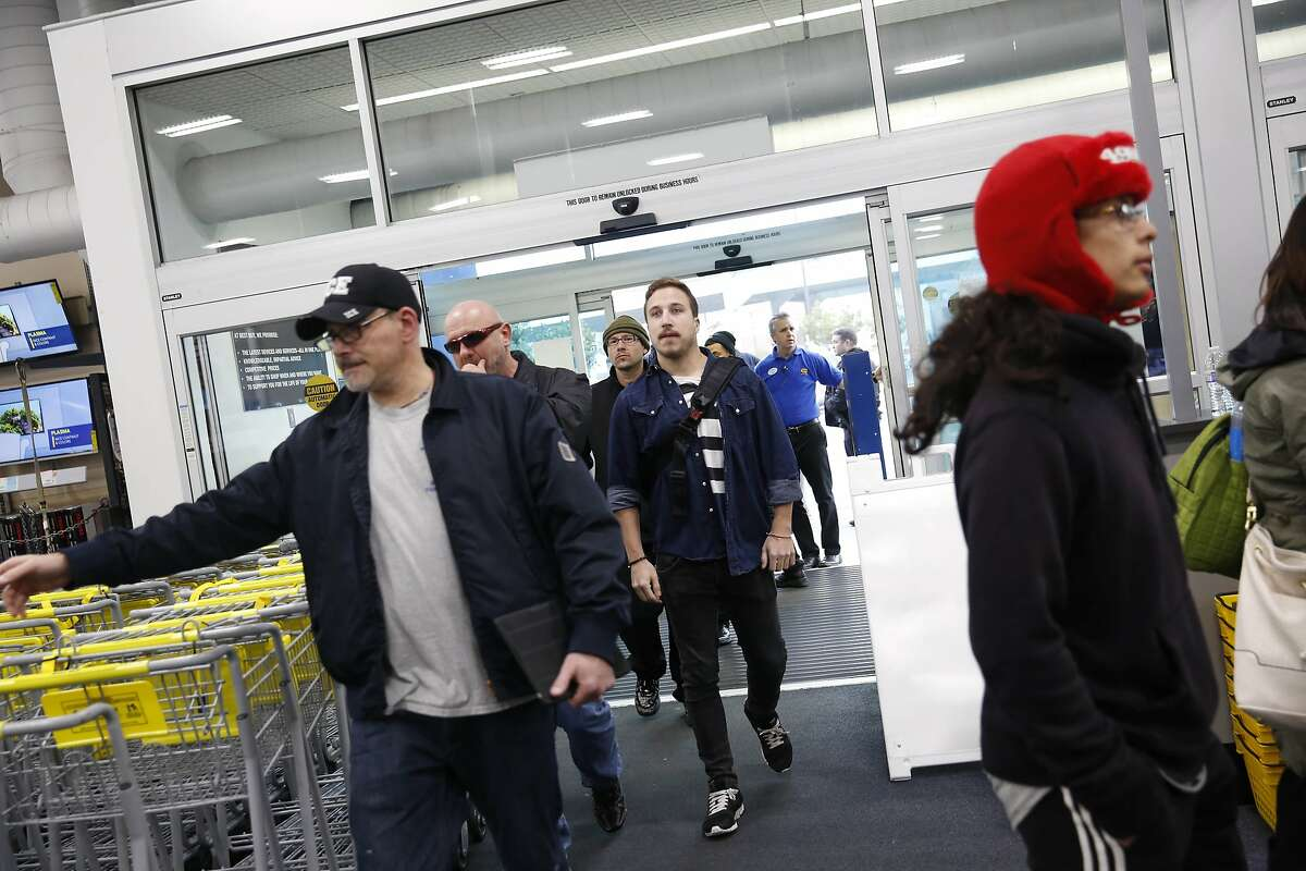 Shoppers enter the Best Buy store as it opens on Friday, November 28, 2014 in San Francisco, Calif.