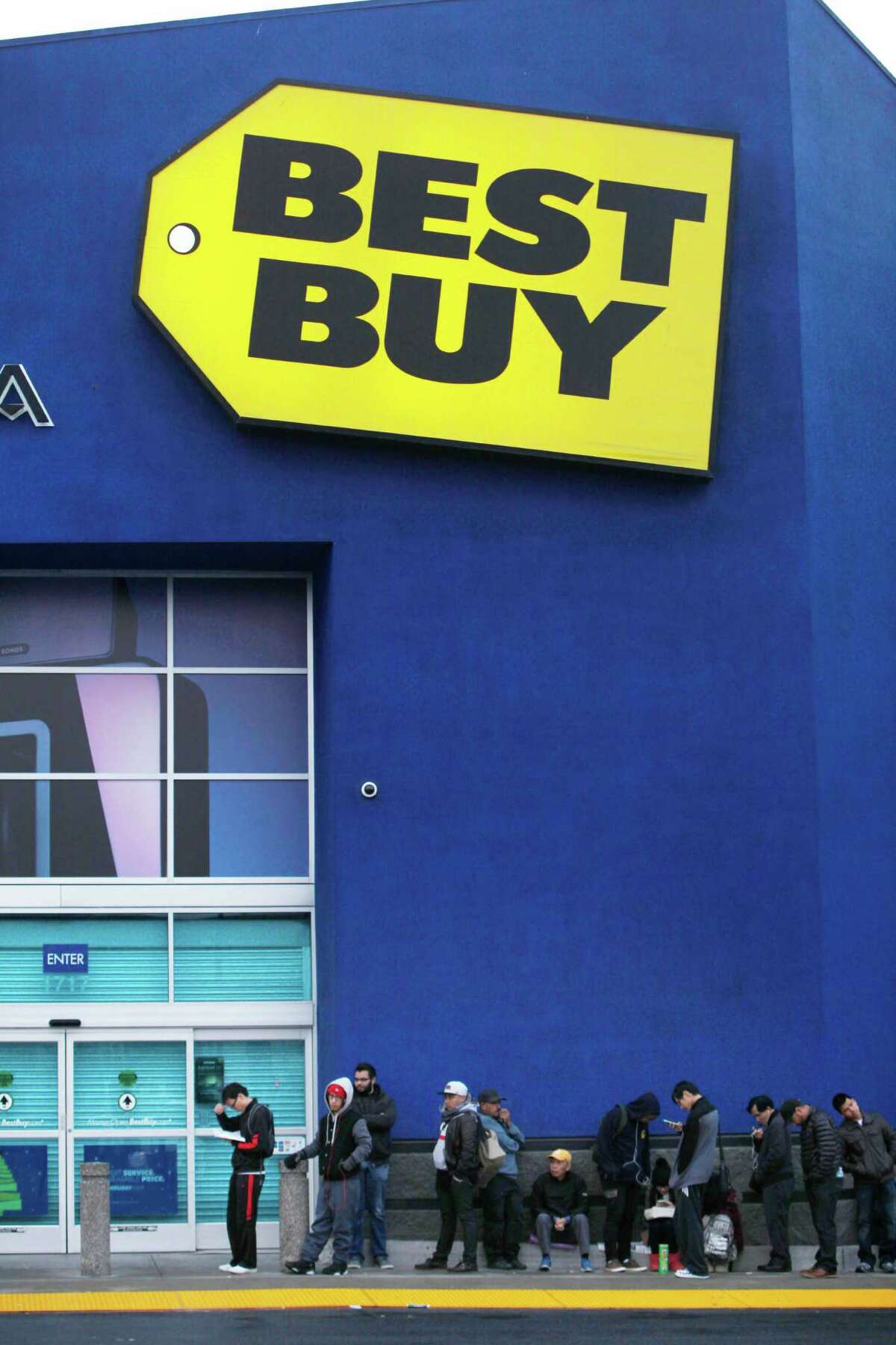 A line of shoppers wait outside of Best Buy for the doors to open for Black Fridays sales on Friday, November 28, 2014 in San Francisco, Calif.