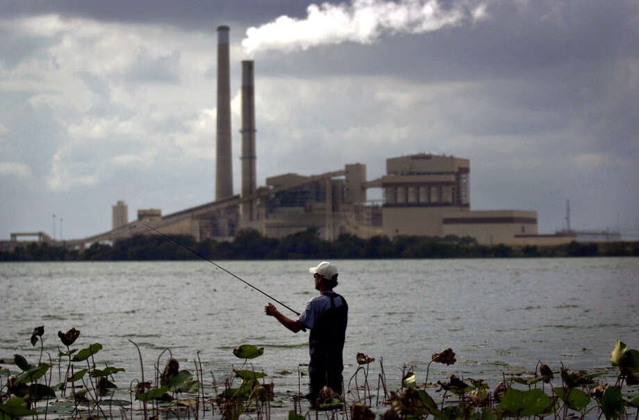 Emissions rise from the smokestack at the J.K. Spruce power plant seen beyond the Calaveras Lake. CPS built Calaveras and Braunig lakes in the 1950s as a dependable source of water during the drought of that era. Now the two lakes accommodate a majority of its water needs, according to CPS. Photo: Nicole Fruge, Staff / San Antonio Express-News / San Antonio Express-News