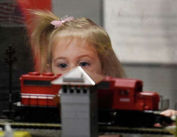 A young visitor enjoys the train display at the Museum of Innovation and Science Friday morning Nov. 28, 2014 in Schenectady, N.Y.         (Skip Dickstein/Times Union) Photo: SKIP DICKSTEIN / 00029626A