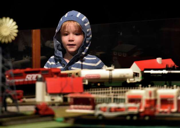 Henry Glennon, 3, of Cape Elizabeth, Maine, enjoys the train display, part of the Trains and Toys display at the Museum of Innovation and Science on Friday morning, Nov. 28, 2014 in Schenectady, N.Y.  The Trains and Toys show runs until Jan. 19, 2015.       (Skip Dickstein/Times Union) Photo: SKIP DICKSTEIN / 00029626A