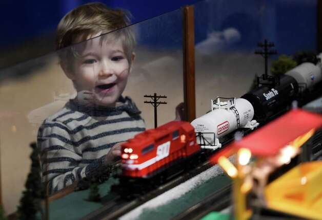 Jack Glennon, 3 of Cape Elizabeth, Maine, enjoys the train display, part of the Trains and Toys display at the Museum of Innovation and Science, Friday morning, Nov. 28, 2014 in Schenectady, N.Y.  The Trains and Toys show runs until Jan. 19, 2015.       (Skip Dickstein/Times Union) Photo: SKIP DICKSTEIN / 00029626A