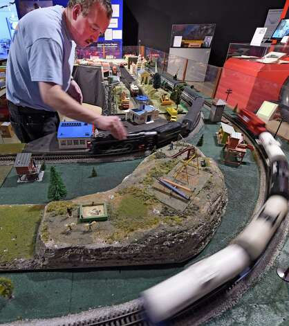 Muesum educator Dan Brown keeps the trains moving at the train display, part of the Trains and Toys display at the Museum of Innovation and Science Friday morning Nov. 28, 2014 in Schenectady, N.Y.  The Trains and Toys show runs until Jan. 19, 2015.       (Skip Dickstein/Times Union) Photo: SKIP DICKSTEIN / 00029626A