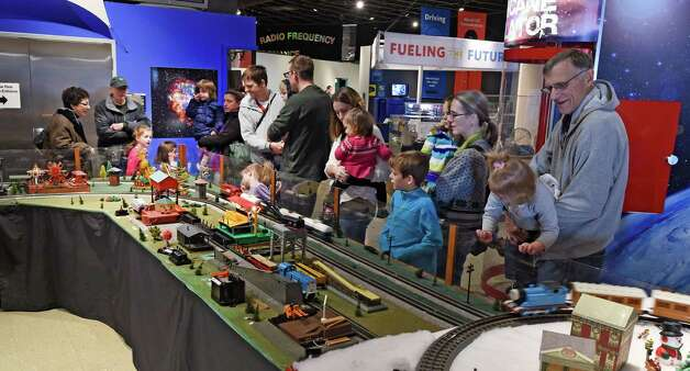 The train display draws a large crowd at Trains and Toys show at the Museum of Innovation and Science, Friday morning, Nov. 28, 2014, in Schenectady, N.Y.  The Trains and Toys show runs until Jan. 19, 2015.       (Skip Dickstein/Times Union) Photo: SKIP DICKSTEIN / 00029626A