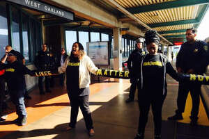 14 arrested in peaceful protest that disrupts BART - Photo