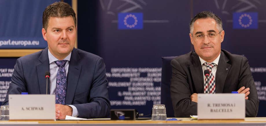 European Parliament members Andreas Schwab (left) of Germany and Ramon Tremosa i Balcells of Spain discuss the Google antitrust case. Photo: Geert Vanden Wijngaert / Associated Press / AP