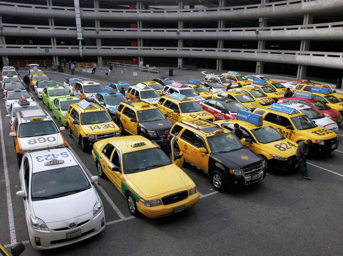 Cabs in a staging area await service at San Francisco International Airport.