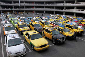 To save their jobs, cabbies must pull up to the future - Photo