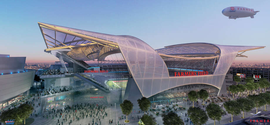 This rendering shows the design of a Los Angeles stadium that would be developed by Anschutz Entertainment Group. Former Disney CEO Michael Eisner, below, backs the return of football to the city. Photo: Associated Press / AEG
