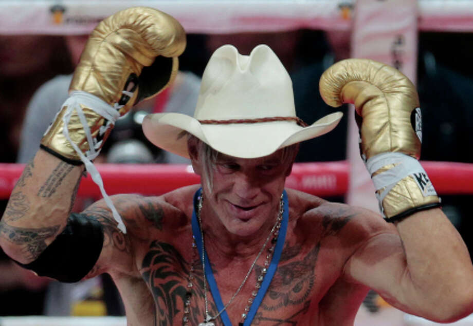 US actor Mickey Rourke celebrates his victory against his opponent Elliot Seymour of the United States, after their professional boxing match at the Luzhniki Stadium, Moscow, Friday, Nov. 28, 2014. Hollywood actor Mickey Rourke returned to the boxing ring Friday at the age of 62, defeating a fighter less than half his age in an exhibition bout. (AP Photo/Ivan Sekretarev) Photo: Ivan Sekretarev / Associated Press / AP