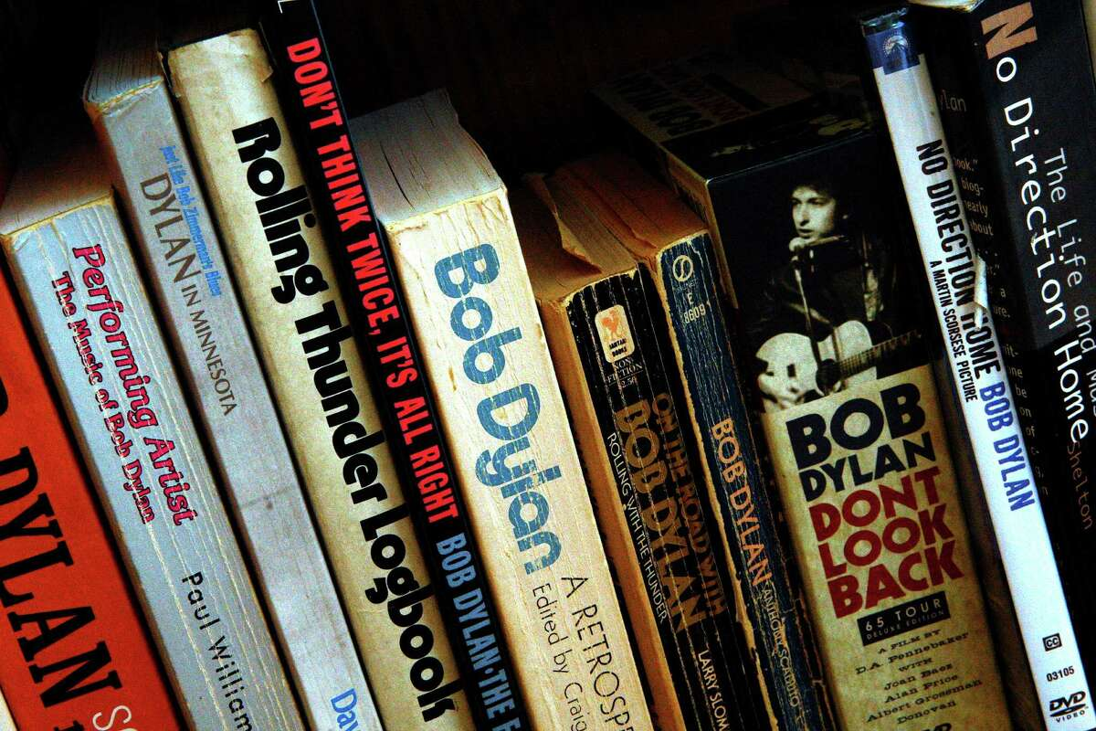 Several books about Bob Dylan seen on a shelf in the office parlor of Dennis McNally as he talks about his new book