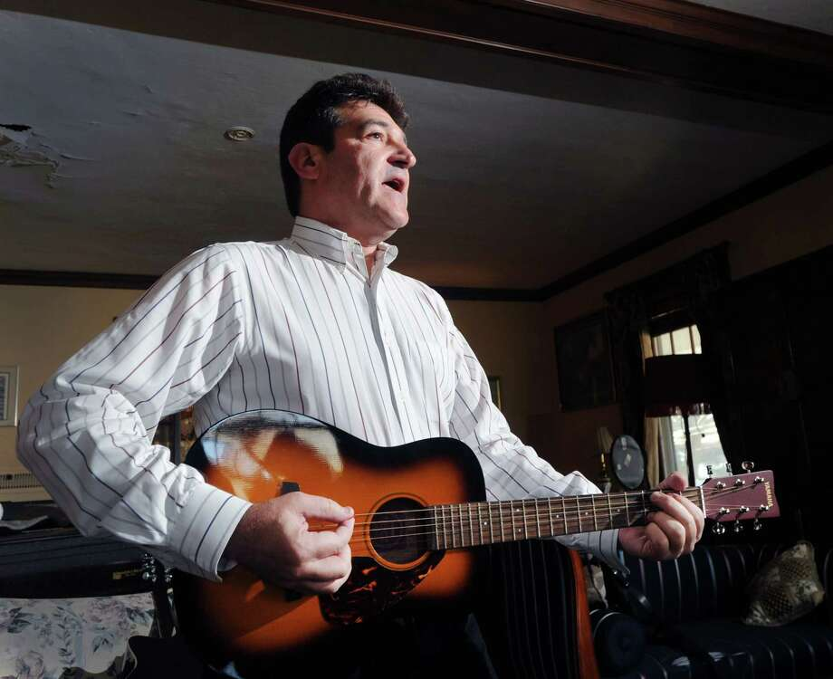 "Marc Ferris, author of the new book on the national anthem titled ""Star-Spangled Banner: The Unlikely Story of America's National Anthem,"" sings and plays guitar while performing his version of the song at his home in Greenwich, Conn., Friday, Nov. 28, 2014. Photo: Bob Luckey / Greenwich Time"