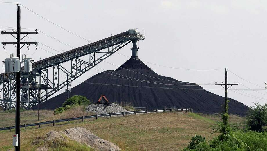 This 2013 photo shows a Luminant Mining Co. coal mine working in Tatum. Dallas-based Luminant, the state's largest power generator, opposes the Clean Power Plan. Photo: Associated Press File Photo / AP