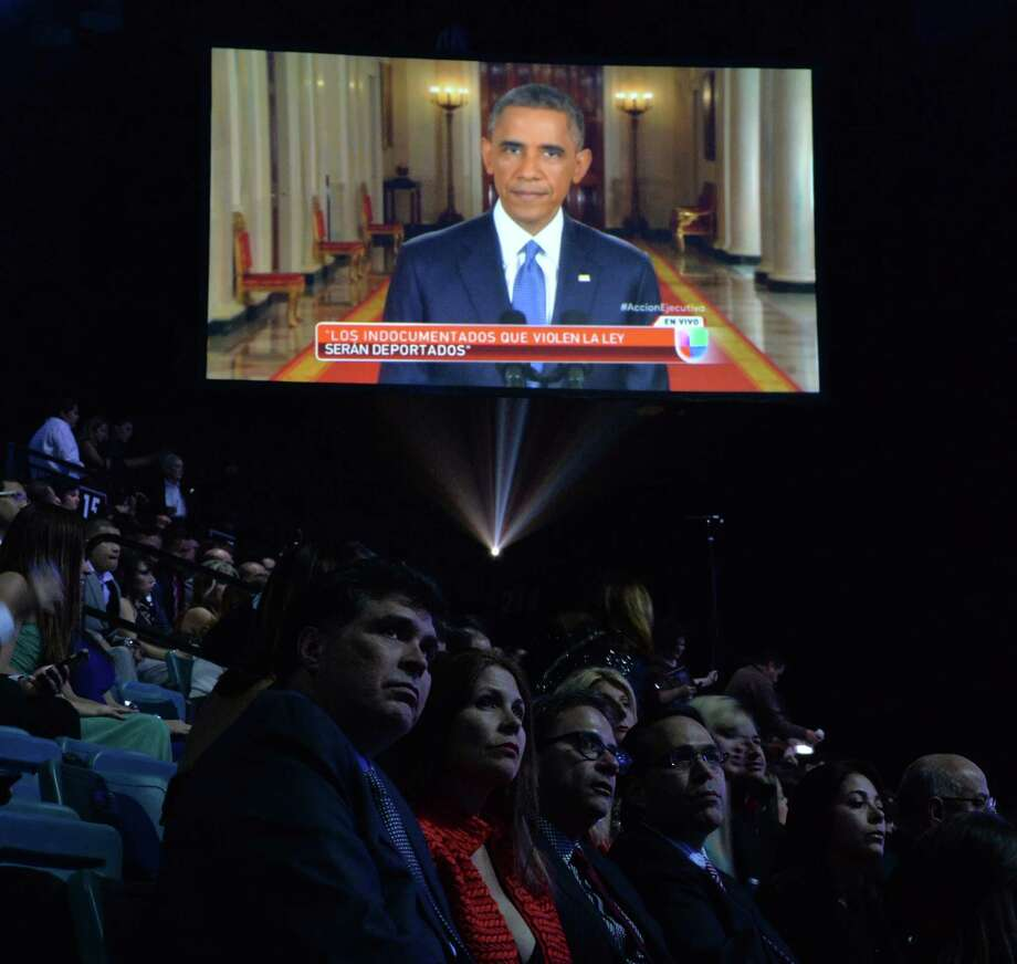 The audience at the 15th Annual Latin Grammy Awards show in Las Vegas watches as President Barack Obama delivers a nationally televisied speech on immigration on November 20. Our readers have differing takes on the message — and the plan — outlined by the president. Photo: MARK RALSTON / MARK RALSTON / AFP/Getty Images / AFP