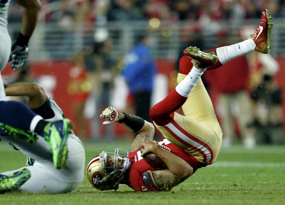 Quarterback Colin Kaepernick goes down on a fourth-quarter scramble on Thursday, one of his few runs in the game. Photo: Scott Strazzante / The Chronicle / ONLINE_YES