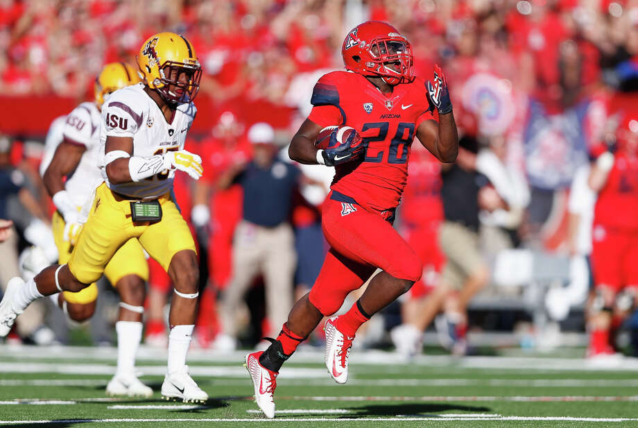 Arizona running back Nick Wilson heads for the end zone on a 72-yard run in the third quarter of his team's win over Arizona State. Photo: Christian Petersen / Getty Images / 2014 Getty Images